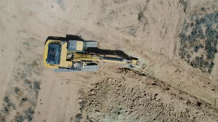 bagger : Aerial footage of heavy earth moving machines at work