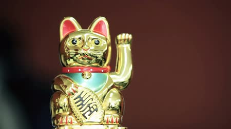 tittle : Statuette of a cat waves a paw. For captions. Stock Footage