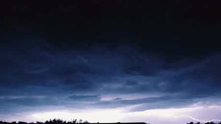 electrostatic : Slow motion video clip of night sky with lightning and stormy clouds.