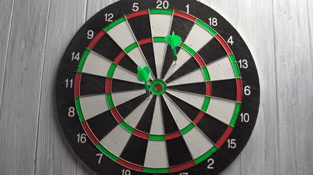 dart : Playing Darts on White Wood Wall Stock Footage