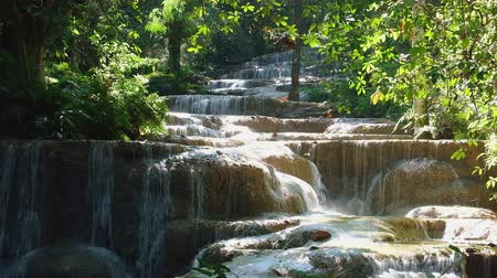 Seamless 4K Video, Beautiful waterfall in nature,  water flowing from the river.