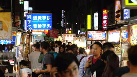 1st October 2019, Taipei, Taiwan - Night market scene in the evening. Crowded people and vendor in the street. 4K Video.