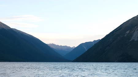 The sunset scene at lake, Mountain Range View. Nelson Lake National Pakr, New Zealand. 4K Video Stock mozgókép