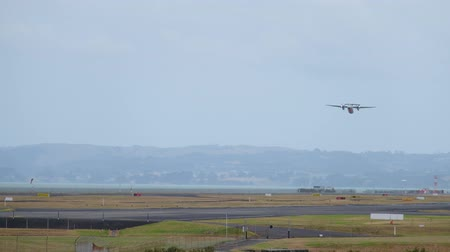 urlop : A scene when an airplane is taking off from the airport. 4K Video, Auckland International Airport, New Zealand.