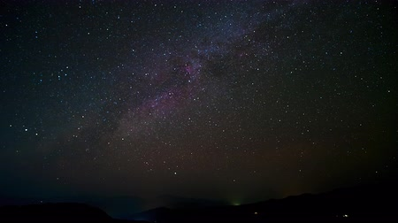 Timelapse, Beautiful starry night. Many stars moving above the high mountain in the dark night. 4K Video.