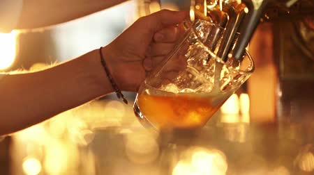 beer tap : Male hands pour beer into a glass