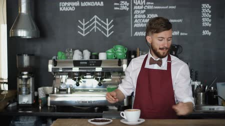 barbate : Young barista with cup of coffee