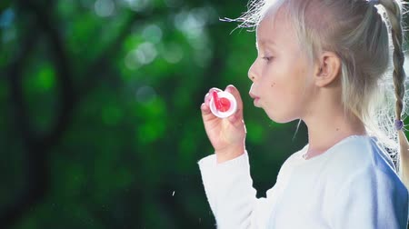 hůlky : Little girl with a soap bubbles in summer