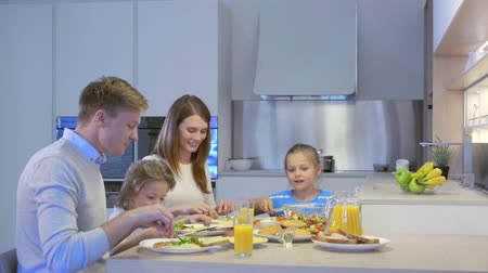 prole : Family with kids in kitchen Stock Footage