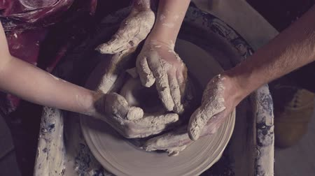 clay pot : Hands making a vase on a potters wheel Stock Footage