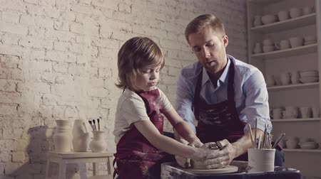 clay pot : Family in aprons in a pottery