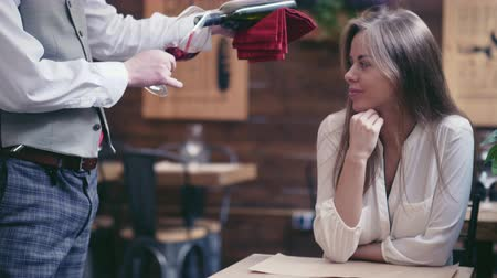 red wine : Young waiter pours wine to a girl