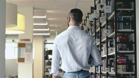 Young man in a library Stock Footage