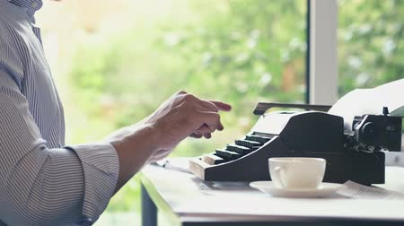 poeta : Typing writer indoors
