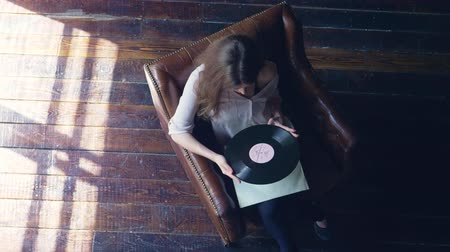 disk : Young girl with a phonograph record