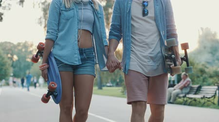 longboard : Young couple outdoors Stock Footage