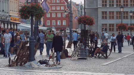 wrocław : A group of people on the square in Wroclaw