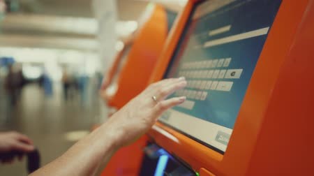 ticket machine : Female hand at the airport Stock Footage