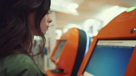 ticket machine : Young girl at the airport terminal Stock Footage