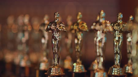 statuette : Golden statuettes of Oscar closeup