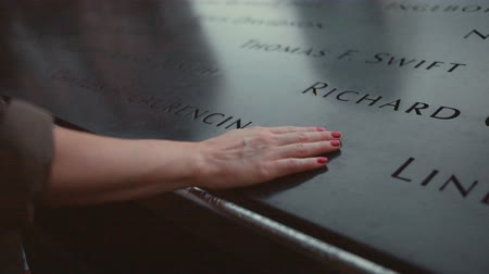 запомнить : Female hand on the monument of 911 Memorial close-up