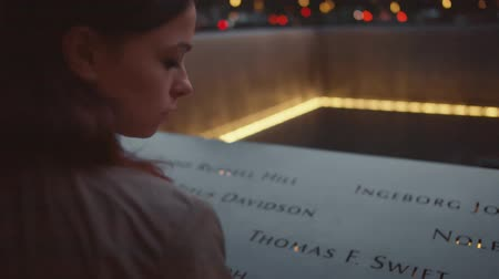eleven people : Attractive girl holding hand on the 911 Memorial Stock Footage