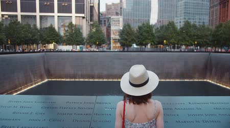 eleven people : Young girl at the memorial symbol in New York City in the summer Stock Footage