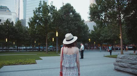 eleven people : Young girl walking in a park in New York City