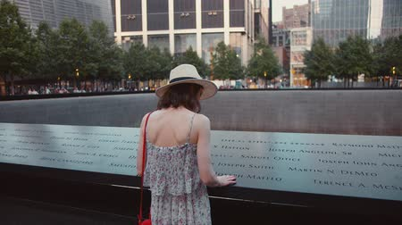 eleven people : Young girl reading names at a memorial symbol in New York City Stock Footage