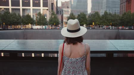 eleven people : Young woman at the memorial symbol in New York City
