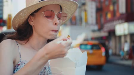 kluski : Young girl eating Chinese food in Manhattan in New York City