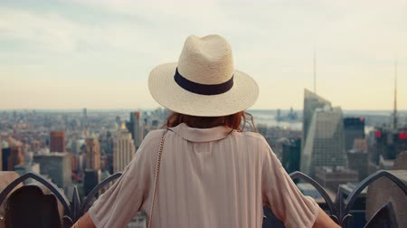 new york city : Young girl looking at the view from above