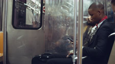 Young passenger in a subway train in New York