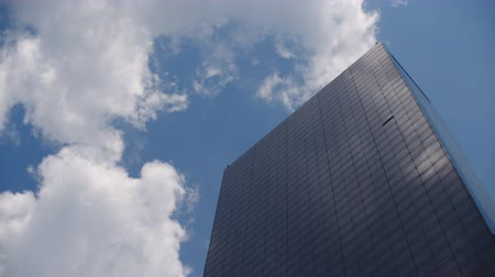 Clouds floating over a glass building in New York Stock Footage