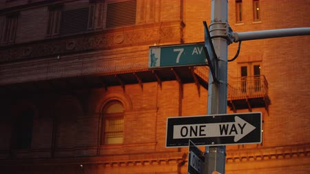 Urban street signs in New York City at night