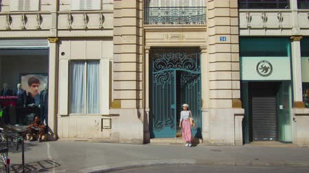 Young tourist leaving a building, Paris Stock Footage