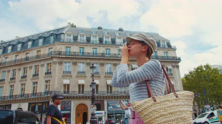 Young woman taking photo in Paris, France