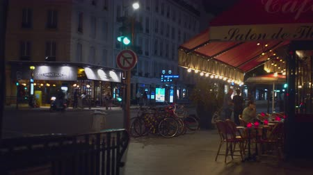 Famous cafe in Paris, France at night
