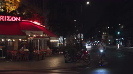 Popular cafe in Paris, France at night Stock Footage