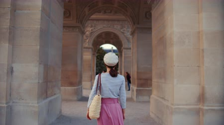 Young girl at the arch in Paris