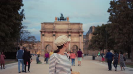 Attractive tourist by the arch at Carrousel, Paris