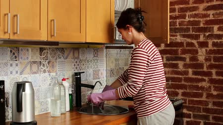 dish : Caucasian woman washing dishes at home