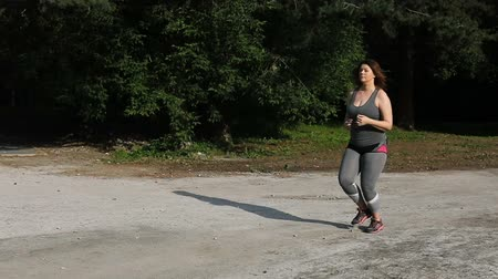 nadváha : Overweight woman running. Weight loss concept. Dostupné videozáznamy