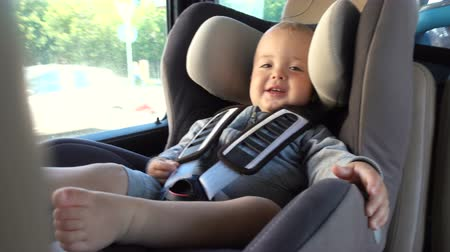inside car : Little baby in booster chair in car