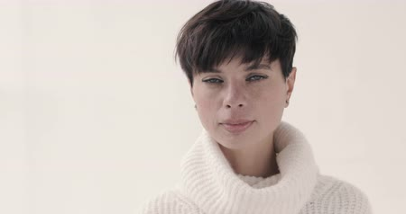 rövid : Beautiful woman with a short haircut brunette in a warm sweater White background