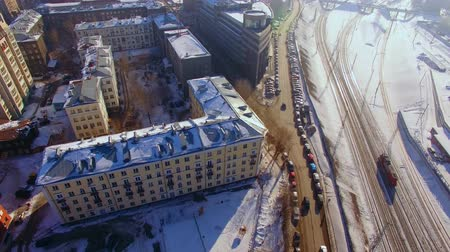 mozdony : Aerial drone footage over city winter day.Urban smog. Top view of railway tracks Stock mozgókép