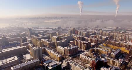 bad ecology : Flying on the copter over the winter city. Urban smog, on the horizon Stock Footage