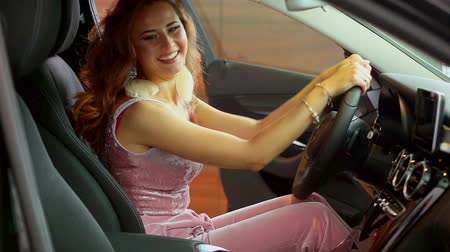 custo : Beautiful young businesswoman buying new car. Shes very happy