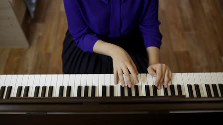 rehearsing : Hands teenager girl playing on the keyboard of the digital piano