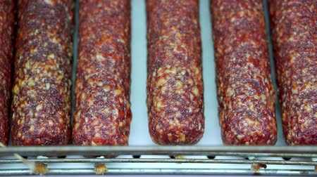 produce market : Smoked sausage is on the shelf in the store. Choosing and buying food in the supermarket